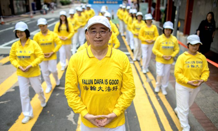 Falun Gong practitioners take part in a march in Hong Kong on April 27, 2019. (DALE DE LA REY/AFP via Getty Images)