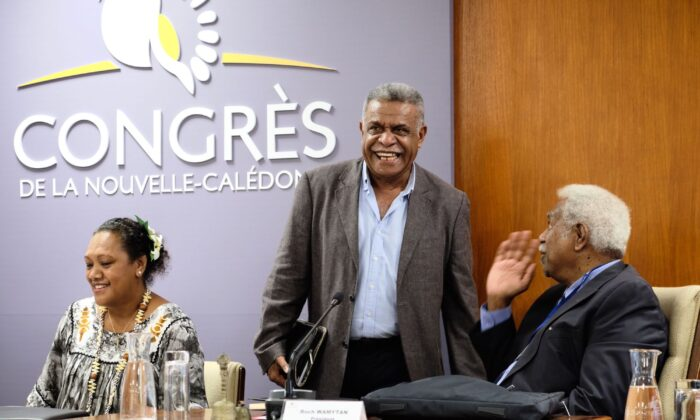 Louis Mapou, who was just elected as president of New Caledonia, speaks with the President of the Congress Roch Wamytan (Union Calédonienne) as they attend the elections to form the 17th government of New Caledonia, in Noumea, on Feb. 17, 2021. (Theo Rouby / AFP via Getty Images)