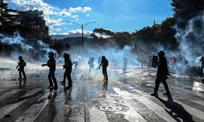Demonstrators clash with riot police during a protest against the government in Medellin, Colombia, on June 28, 2021. (Joaquin Sarmiento/AFP via Getty Images