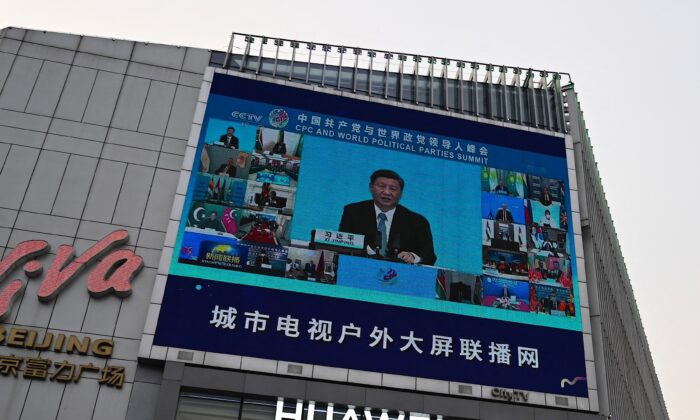 A screen outside a shopping mall shows news coverage of Chinese leader Xi Jinping delivering a speech during a Communist Party of China and World Political Parties summit, in Beijing on July 7, 2021. (Jade Gao/AFP via Getty Images)