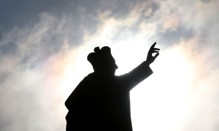 A statue is seen silhouetted by the sun at St. Mary's Cathedral in Sydney, Australia, on Oct. 23, 2020. (Lisa Maree Williams/Getty Images)