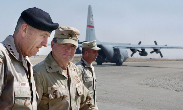 U.S. Commander of Central Command, Gen. Tommy Franks (L) is greeted by Task Force Rakkasan Commander Col. Francis Wiercinski (C) on May 15, 2002 at Kandahar airbase in southern Afghanistan. Franks stopped at the base to personally address the troops deployed there as part of Operation Enduring Freedom. (Scott Nelson/Getty Images)