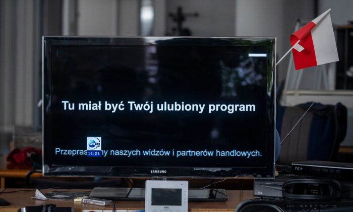 """The screen of a TV is pictured broadcasting a black board and reading """"This should be your favorite program"""" on the TVN channel as a sign of protest against a tax proposed by the new government, in Warsaw, on Feb. 10, 2021.  (Wojtek Radwanski/AFP via Getty Images)"""