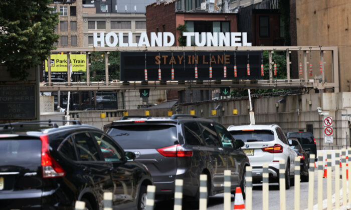 Vehicles wait in traffic to enter Holland Tunnel in Lower Manhattan, New York City on July 2, 2021. (Michael M. Santiago/Getty Images)