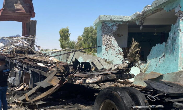 A truck from which rockets were launched towards Ain Al-Asad Military Base is seen at Anbar province, in al-Baghdadi, Iraq, on July 8, 2021. (Joint Operations Command Media Office/Handout via Reuters)