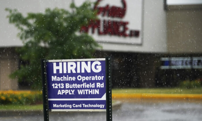 A hiring sign is displayed in Downers Grove, Ill., on June 24, 2021. (Nam Y. Huh/AP Photo)