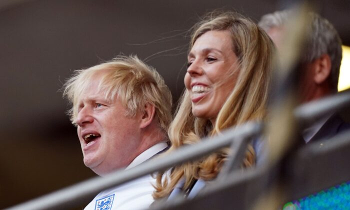 Prime minister Boris Johnson and Carrie Johnson in the stands during the UEFA Euro 2020 semi final match at Wembley Stadium, London, on July 7, 2021. (Mike Egerton/PA)