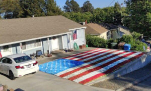 US Army Veteran Spray Paints Huge American Flag on Front Lawn for Fourth of July