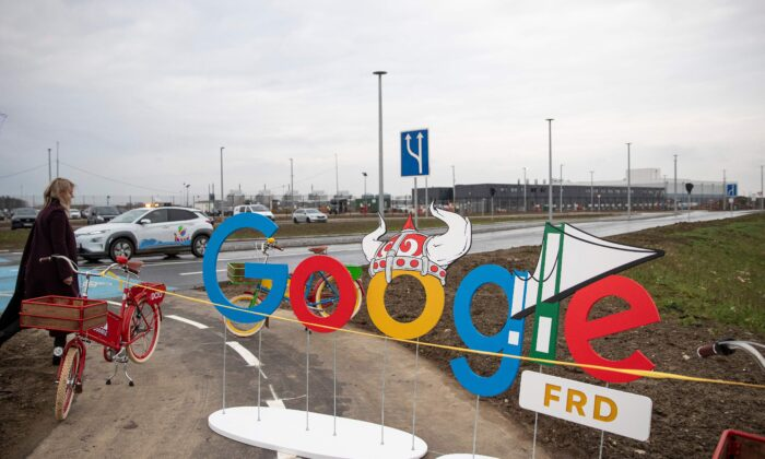 A woman passes by a google-themed barrier in front of a Google data center in Fredericia, Denmark, on Nov. 30, 2020. (Frank Cilius/Ritzau Scanpix/AFP via Getty Images)
