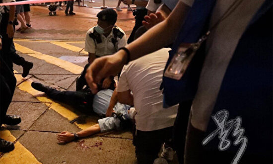 Reporter's Travel Documents Seized After Filming Assault on Hong Kong Police
