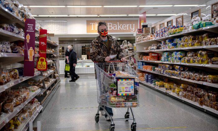 A man wearing a Union Jack flag design face mask shops in a Sainsburys supermarket in Tunbridge Wells, UK, on Jan. 12, 2021. (Chris J Ratcliffe/Getty Images)