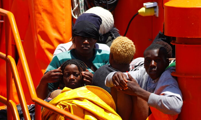 Migrants wait to disembark from a Spanish coast guard vessel, in the port of Arguineguin, on the island of Gran Canaria, Spain, on June 20, 2021. (Borja Suarez/Reuters)