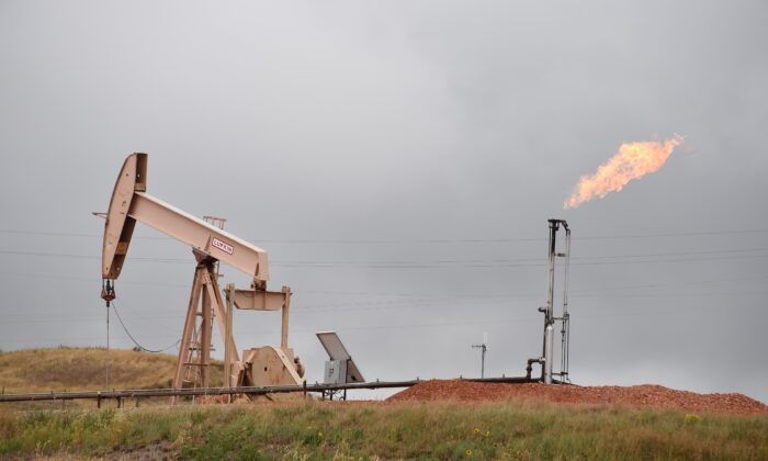 Pump jacks and a gas flare are seen near Williston, N.D., on Sept. 6, 2016. (Robyn Beck/AFP via Getty Images)