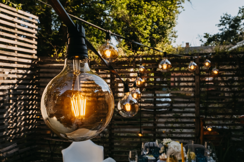 Light,Bulbs,Outdoors,At,A,Party,In,Evening,Time.