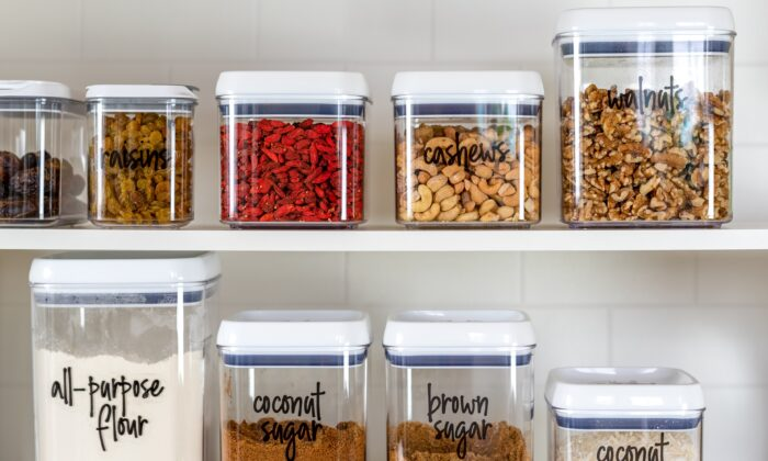Organizing your pantry staples in clear, uniform containers will help save space, reduce visual clutter, and keep food fresh longer. (Kristen Prahl/Shutterstock)