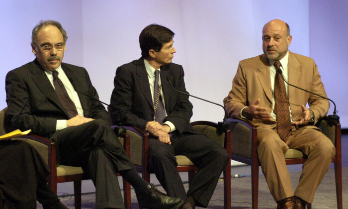 William Karesh, right, is seen during a panel discussion in New York City in a file photograph. (Stan Honda/AFP via Getty Images)