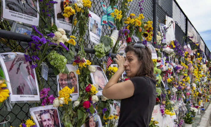 Gini Gonte visits the Surfside Wall of Hope  Memorial in Florida on July 7, 2021 (Al Diaz/Miami Herald via AP)