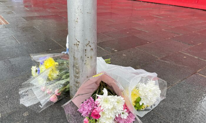 Flowers left near the scene at Woolwich New Road, Greenwich, where a 15-year-old boy was stabbed to death on Monday evening, in London, UK, on July 6, 2021. (Danielle Desouza/PA)