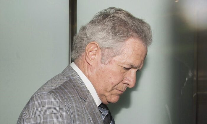 Businessman Tony Accurso arrives at the courthouse for sentencing in Laval, Que., on July 5, 2018. The Crown has dropped its fraud case against a former construction tycoon in Quebec and four co-accused following a nine-year legal battle. (The Canadian Press/Graham Hughes)