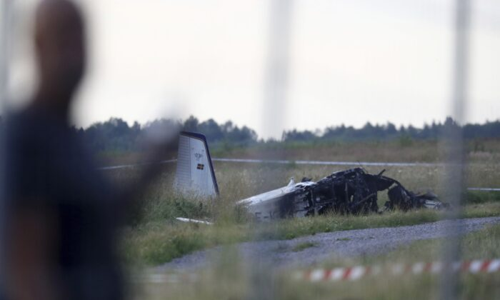 Emergency services at the scene of small aircraft crash, at Orebro Airport in Sweden, on July 8 2021. (Jeppe Gustafsson/TT News Agency via AP)