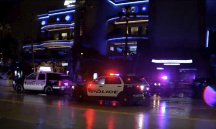 Police vehicles park outside the scene of a restaurant shooting Thursday, July 8, 2021, in Houston, Texas.(KTRK via AP)