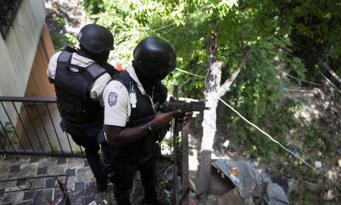 Police search the Morne Calvaire district of Petion Ville for suspects who remain at large in the murder of Haitian President Jovenel Moise in Port-au-Prince, Haiti, on July 9, 2021. (Joseph Odelyn/AP Photo)