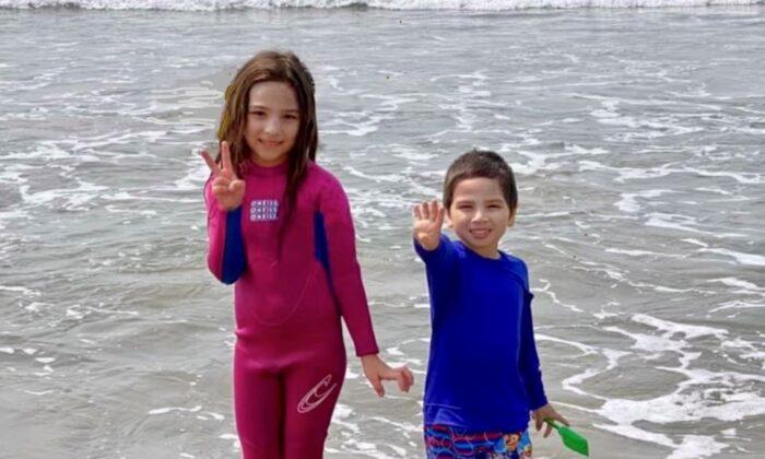Mia and Tyler enjoy the beach. (Karen Brazas)