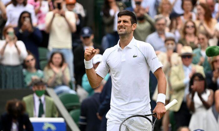 Serbia's Novak Djokovic celebrates winning his quarter final match against Hungary's Marton Fucsovics in London, Britain on July 7, 2021. (REUTERS/Toby Melville)
