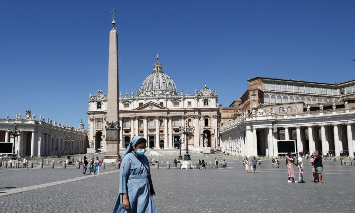 A nun walks across St. Peter's Square in Vatican City on July 6, 2021. (Isabella Bonotto/AFP via Getty Images)