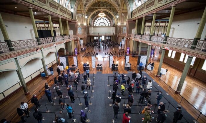 People wait to be register their information before being vaccinated  at the Royal Exhibition Building COVID-19 Vaccination Centre in Melbourne, Australia on May 28, 2021. (Darrian Traynor/Getty Images)