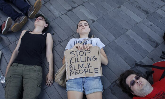 Demonstrators take part in a die-in during a Michael Brown memorial protest in Brooklyn, New York on Aug. 9, 2015. (Kena Betancur/AFP via Getty Images)