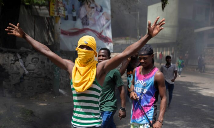 People protest against the assassination of Haitian President Jovenel Moïse near the police station of Petion Ville in Port-au-Prince, Haiti, on July 8, 2021. (Joseph Odelyn/AP Photo)