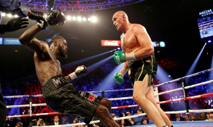 Tyson Fury knocks down Deontay Wilder during their Heavyweight bout for Wilder's WBC and Fury's lineal heavyweight title at MGM Grand Garden Arena in Las Vegas, Nev., on Feb. 22, 2020. (Steve Marcus/Reuters)