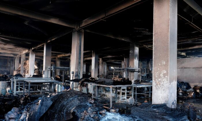 Burnt material is seen inside a food and beverage factory in Rupganj, outside Dhaka, Bangladesh, on July 9, 2021. (Mahmud Hossain Opu/AP Photo)