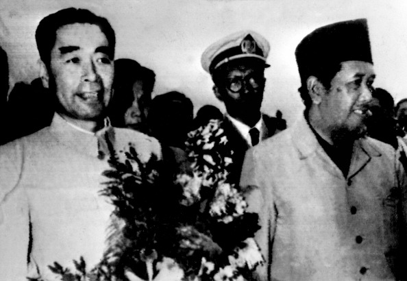 Zhou Enlai, foreign minister of the People's Republic of China, is welcomed by Indonesian Prime Minister Aly Sasto-Amidjojo on April 18, 1955 as he arrives at Bandung Conference of Asian and African States which met from April 18 to 24. (AFP via Getty Images)