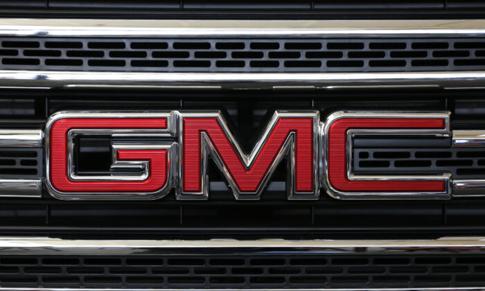 GMC logo on grill of a 2016 GMC Canyon on display at the Pittsburgh International Auto Show in Pittsburgh Thursday, Feb. 11, 2016. (AP Photo/Gene J. Puskar)