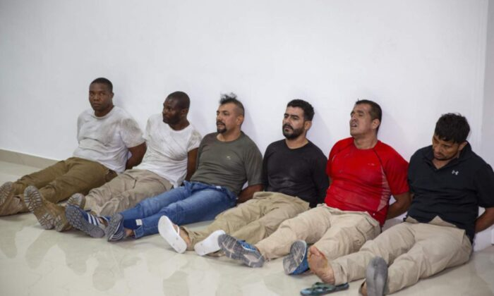 Suspects in the assassination of Haiti's President Jovenel Moïse, among them Haitian American citizens James Solages, left, and Joseph Vincent, second left, are shown to the media at the general direction of the police in Port-au-Prince, Haiti, on July 8, 2021. (Joseph Odelyn/AP Photo)