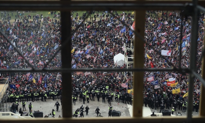 Police and protesters outside the U.S. Capitol's Rotunda in Washington on Jan. 6, 2021. (Olivier Douliery/AFP via Getty Images)