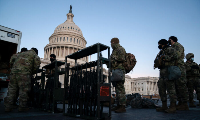 Weapons are distributed to members of the National Guard outside the U.S. Capitol in Washington, on Jan. 13, 2021. (Stefani Reynolds/Getty Images)