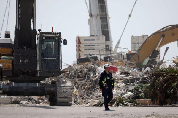 rescue-worker-at-condo-site