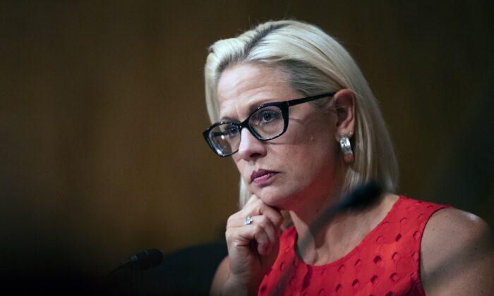 Sen. Kyrsten Sinema (D-Ariz.) is seen during a hearing in Washington on July 16, 2019. (Manuel Balce Ceneta/AP Photo)