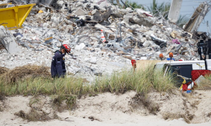 A rescue worker is seen as search-and-rescue efforts resume at Champlain Towers South complex in Surfside, Fla., on July 5, 2021. (Marco Bello/Reuters)
