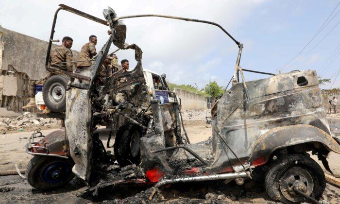 A wreckage of a rickshaw is seen at the scene of a car explosion near Banadir hospital in Mogadishu, Somalia on July 10, 2021. (Feisal Omar/Reuters)