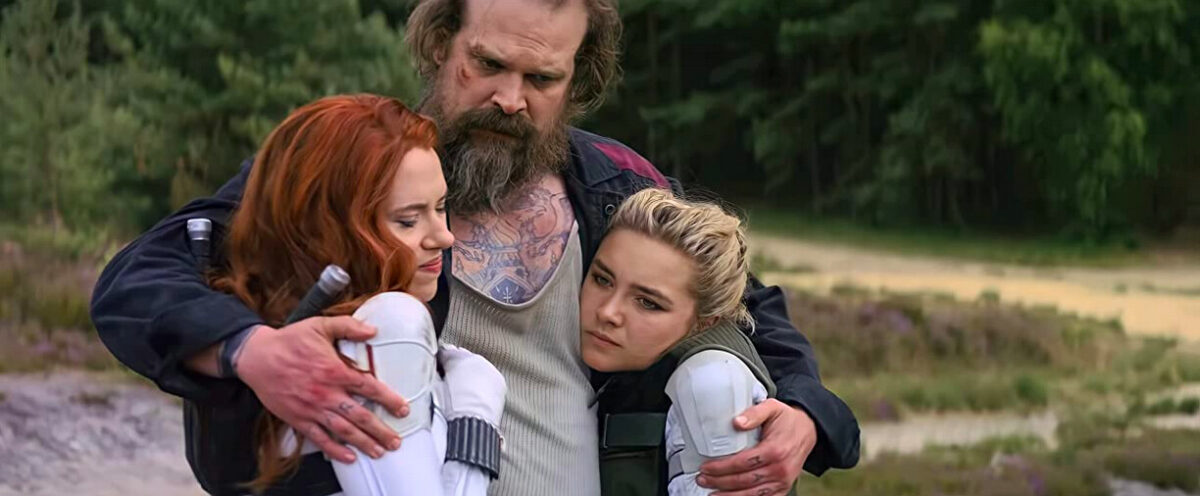 two woman and one man hug in Black Widow