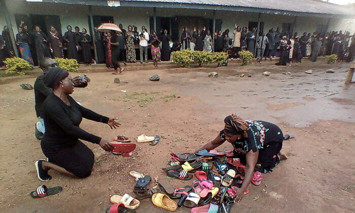 Parents of students abducted at Bethel Baptist High School pray for their safe return around discarded shoes left behind by the children, in Kaduna, Nigeria, on July 9, 2021. (Bosan Yakusak/Reuters)