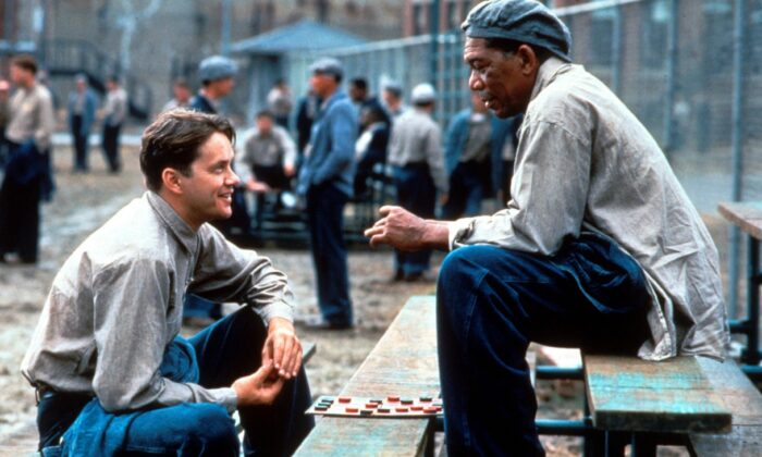 Tim Robbins (L) and Morgan Freeman play characters who find friendship in a dark and hopeless prison. (Columbia Pictures)