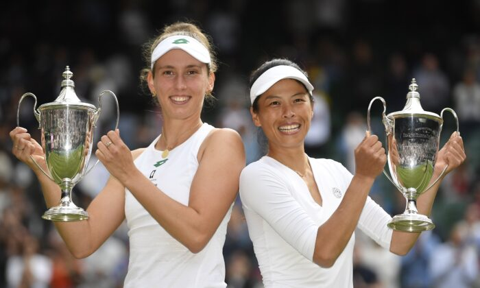 Taiwan's Hsieh Su-wei and Belgium's Elise Mertens celebrate with the trophies after winning the women's doubles final against Russia's Elena Vesnina and Veronika Kudermetova at The Wimbledon Tennis Championships in London, UK, on July 10, 2021. (Toby Melville/Reuters)