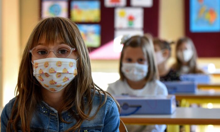 Montenegrin schoolchildren wearing protective masks to prevent the spread of the COVID-19 in Podgorica, on Sept. 30, 2020. (Savo Prelevic/AFP via Getty Images)