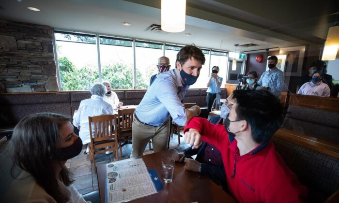 Prime Minister Justin Trudeau greets people having lunch at a White Spot restaurant in Coquitlam, B.C., on July 8, 2021. (The Canadian PressDarryl Dyck)