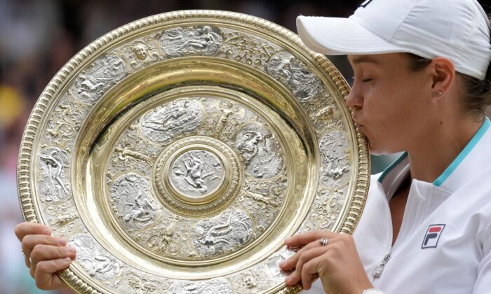 Australia's Ashleigh Barty poses with the trophy for the media after winning the women's singles final after defeating the Czech Republic's Karolina Pliskova on day twelve of the Wimbledon Tennis Championships in London, England, on July 10, 2021. (Kirsty Wigglesworth/AP Photo)